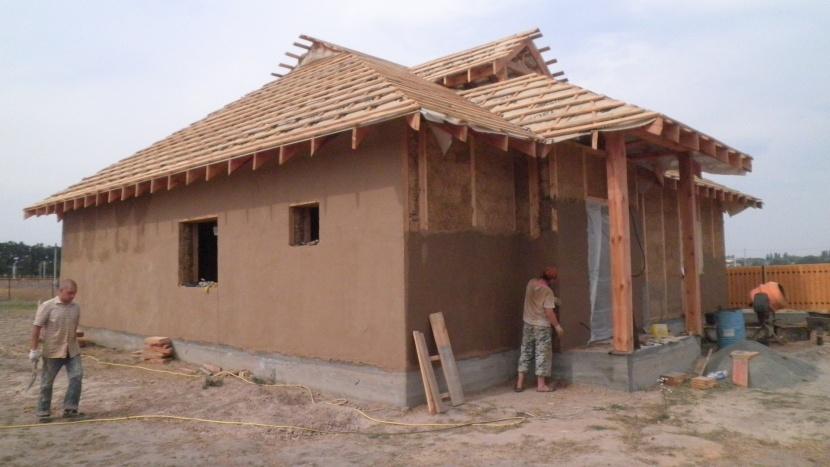 Утепление деревяного дома глиной